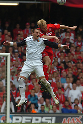 CARDIFF, WALES - SATURDAY, MAY 13th, 2006: Liverpool's Sami Hyypia and West Ham United's Dean Ashton during the FA Cup Final at the Millennium Stadium. (Pic by Jason Roberts/Propaganda)