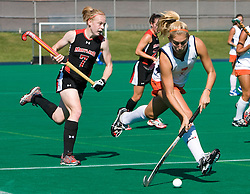 Virginia Cavaliers forward Kaitlyn Hiltz (7) runs past Maryland Terrapins Back Emma Thomas (7).  The #1 ranked Maryland Terrapins defeated the #10 ranked Virginia Cavaliers 4-3 in overtime in NCAA Field Hockey at the Turf Field on the Grounds of the University of Virginia in Charlottesville, VA on October 4, 2008.