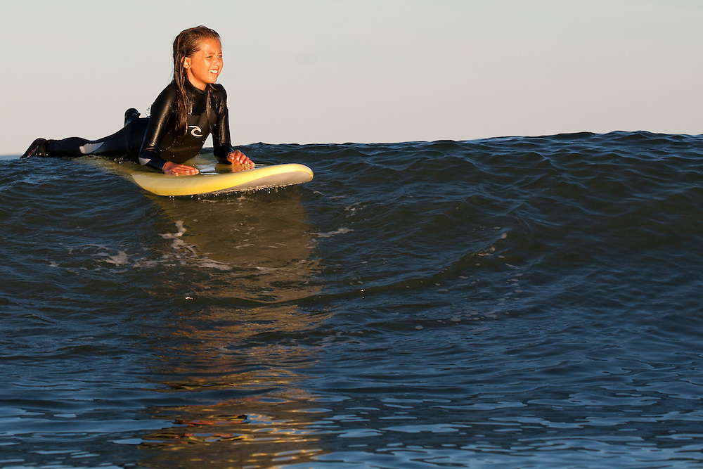 Girl Surfing at Jenness Beach, Rye New Hampshire