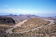 scenic road leading through a desert landscape - Sit Greaves Pass America
