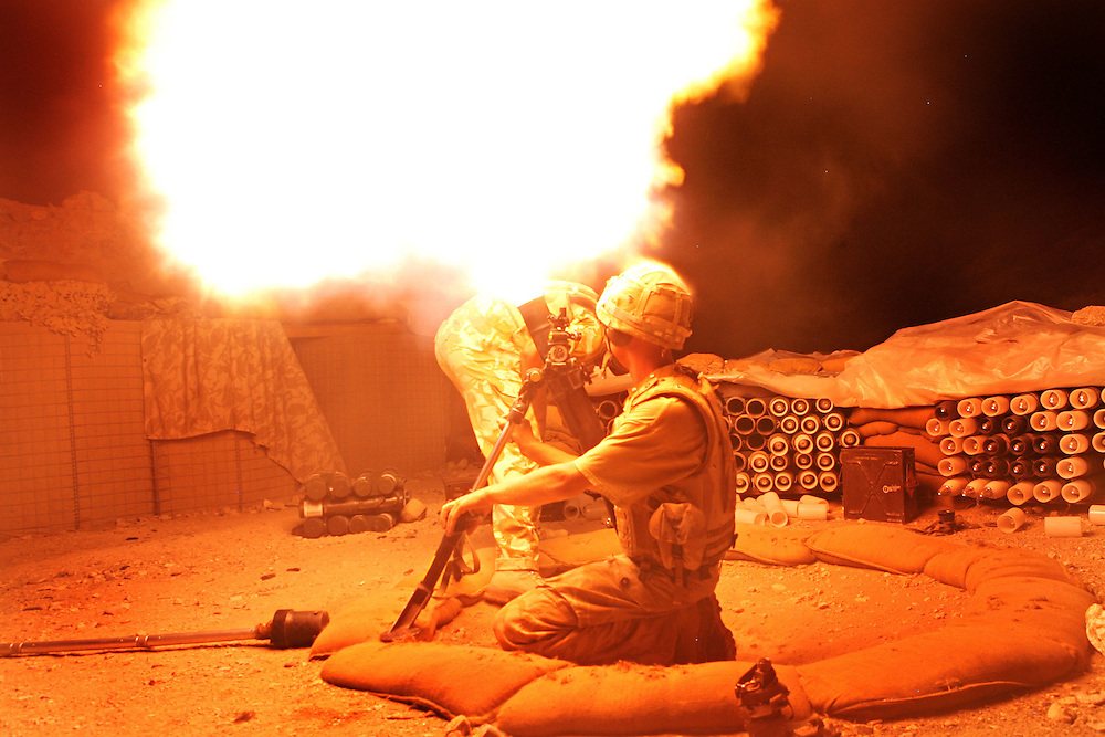 7th July 2007.Kajaki, Helmand Province, Afghanistan..A mortar team from 1 Royal Anglian Battlegroup fire 81mm mortars at Taliban positions after a nightime rocket attack against their base on the 7th of July 2007 in Kajaki, Helmand Province, Afghanistan.
