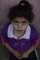 59613200  .A Palestinian refugee girl looks on in the northern Gaza Strip town of Beit Lahiya on May 7, 2013. An increasing number of Gazan families were reportedly falling further into poverty, with unemployment rate at over 30% according to 2012 estimates, May 7, 2013. Photo by:  imago / i-Images.UK ONLY