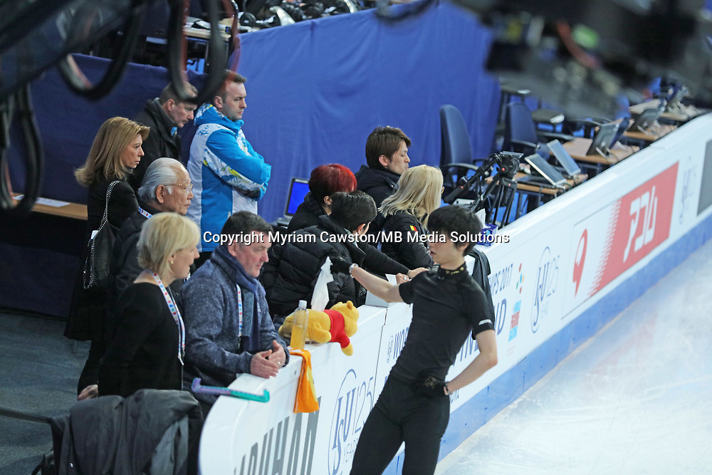 Helsinki, Finland - March 28<br />Figure Skater Yuzuru Hanyu, from Japan, retrieves a hanky from his trademark Pooh bear during morning practice session at the main rink of the Harwall Arena ahead of the Figure Skating World Championships. (Photo by Myriam Cawston/MB Media Solutions)