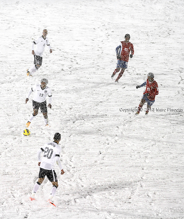 SHOT 3/22/13 9:43:06 PM - United States midfielder Jermaine Jones #13 looks to pass the ball to a teammate on a snow covered pitch against Costa Rica during their World Cup qualifying game at Dick's Sporting Goods Park in Commerce City, Co. on Friday March 22, 2013. The U.S. won the game 1-0 in a spring blizzard that blanketed the pitch and stadium in snow. (Photo by Marc Piscotty / © 2013).