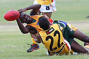 POTCHEFSTROOM, SOUTH AFRICA - JANUARY 28, Moni Yonela (WC Magpies) of the SA Lions is caught by Callum AhChee (Armadale, WA) of the Australian Boomerangs during the AFL Game 1 match between the Flying Boomerangs and South African Lions under 18's at Mohadin Cricket Ground on January 28, 2013 in Potchefstroom, South Africa.Photo by Roger Sedres /