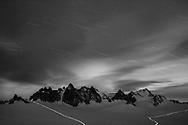 Star trails and the lights of alpinists on the glacier Plateau du Trient with Les Aiguilles Dorees at night with moonshine, Trient, Switzerland<br /> <br /> Impressionen beim Gletscherbecken Plateau du Trient oberhalb Martigny an einem Spätsommertag im September
