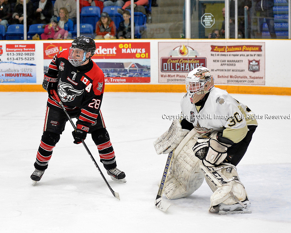 TRENTON, ON  - APR 15,  2017: Ontario Junior Hockey League, Championship Series.  Georgetown Raiders vs the Trenton Golden Hawks in Game 2 of the Buckland Cup Final.  Josh Dickinson #28 of the Georgetown Raiders gets into position in front of goaltender Elliot Gerth #30 during the second period.<br /> (Photo by Shawn Muir / OJHL Images)