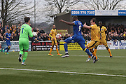 AFC Wimbledon striker Tom Elliott (9) and Sutton United Goalkeeper Ross Worner (1) during The FA Cup match between Sutton United and AFC Wimbledon at Gander Green Lane, Sutton, United Kingdom on 7 January 2017. Photo by Stuart Butcher.