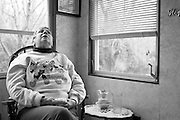 Marie sits in her Killingworth home on April 2, 2009, shortly after being released from the hospital because of heart problems.