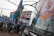 A Cambodia People's Party (CPP) logo is attached to a bus window at a campaign rally for the rulling party in Kampong Cham, Cambodia.