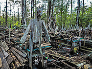Collection of drift wood and scultures behind Adam's Cypress Swamp Driftwood Family Museum in Pierre Part, created by Adam Morales, a self taught artist.