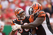 KANSAS CITY, MO - SEPTEMBER 10:  Running back Kenny Watson of the Cincinnati Bengals celebrates a touchdown run with tackle Willie Anderson against the Kansas City Chiefs on September 10, 2006 at Arrowhead Stadium in Kansas City, Missouri..The Bengals won 23 to 10.  (Photo by Wesley Hitt/Getty Images)***Local Caption*** Kenny Watson