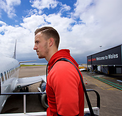 CARDIFF, WALES - Saturday, June 10, 2017: Wales' Lee Evans boards the team plane as the squad depart Cardiff Tesla Airport to travel to Belgrade ahead of the 2018 FIFA World Cup Qualifying Group D match against Serbia. (Pic by David Rawcliffe/Propaganda)