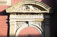 Door detail with segmental pediment with egg and dart decoration from a former Post Office, with V and R (Victoria Reigns) in the spandrels found in Bury, Lancashire, UK