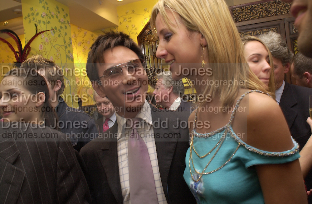Andy Wong and Lady Victoria Hervey. Shanghai Tang opening. Sloane St. 11 April 2001. © Copyright Photograph by Dafydd Jones 66 Stockwell Park Rd. London SW9 0DA Tel 020 7733 0108 www.dafjones.com