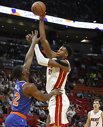 October 24, 2018 - Miami, FL, USA - The Miami Heat's Hassan Whiteside, right, shoots over the New York Knicks' Noah Vonleh, left, in the first half on Wednesday, Oct. 24, 2018, at the American Airlines Arena in Miami. The Heat won, 110-88. (Credit Image: © Carl Juste/Miami Herald/TNS via ZUMA Wire)