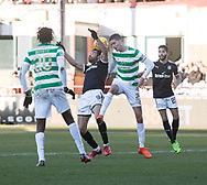 26th December 2017, Dens Park, Dundee, Scotland; Scottish Premier League football, Dundee versus Celtic; Celtic's Mikael Lustig competes in the air with Dundee's Sofien Moussa
