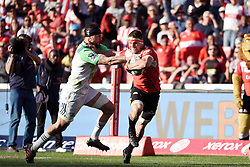 Lion Captain, Jaco Kriel on his way to score a try during the semi final of the Vodacom Super Rugby 2016 season between the Lions and the Highlanders held at the Emirates Airline Park in Johannesburg, South Africa on the 30th July 2016<br /> <br /> Photo by Real Time Images
