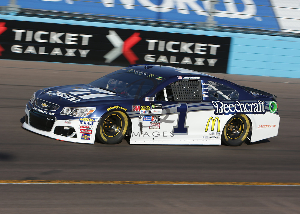 Jamie McMurray qualifies for Sunday's NASCAR Cup Series auto race on Friday, March 17, 2017, in Avondale, Ariz.  (AP Photo/Rick Scuteri)