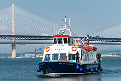 Tourist boat Maid of the Forth at South Queensferry in Scotland, UK
