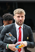 Manchester United defender Luke Shaw (23) arrives at John Smith's Stadium ahead of the Premier League match between Huddersfield Town and Manchester United at the John Smiths Stadium, Huddersfield, England on 5 May 2019.