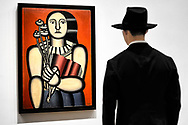 Woman with a Book by Fernand Léger stares down a man with a hat at MoMA.