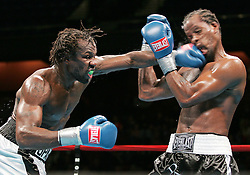 October 21, 2005; Uncasville, CT; USA; Eric Harding (l) lands a left hand to the head of Daniel Judah (r) during their bout at the Mohegan Sun in Uncasville, CT.