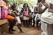 Ghana: 25 April 2012, Women listen to a nurse talk about vaccination and nutrition as they sit with their children at the Dodowa new town health outreach point in Dodowa.The GAVI Alliance is a public-private partnership that brings together developing country and donor governments, WHO, UNICEF, the World Bank, the vaccine industry in both industrialised and developing countries, research and technical agencies, civil society, the Bill & Melinda Gates Foundation and other private philanthropists.  Set up in 2000 as the Global Alliance for Vaccines and Immunisation, GAVI's mission is to save children's lives and protect people's health by increasing access to immunisation in the world's poorest countries.