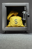 Sack with dollar symbol in safe
