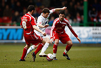 Photo: Richard Lane/Richard Lane Photography. Swindon Town v Norwich City. Coca-Cola Football League One. 20/03/2010. Norwich's Wes Hoolaham is challenged by Swindon's Craig Easton and Alan Sheehan