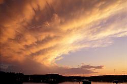 Pretty Marsh, ME. The sun sets over Pretty Marsh Harbor on Mt. Desert Island. Clouds. Boats.
