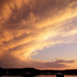 Pretty Marsh, ME. The sun sets over Pretty Marsh Harbor on Mt. Desert Island. Clouds. Boats.