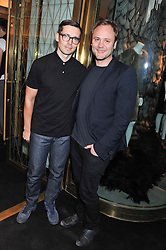 Left to right, ERDEM MORALIOGLU and NICHOLAS KIRKWOOD at a party to celebrate the launch of the Vogue Fashion's Night Out held at Mulberry, Bond Street, London on 6th September 2012.