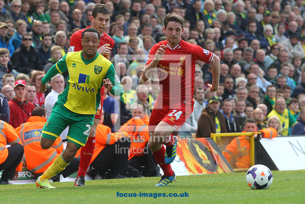 Nathan Redmond of Norwich and Joe Allen of Liverpool in action during the Barclays Premier League match at Carrow Road, Norwich<br /> Picture by Paul Chesterton/Focus Images Ltd +44 7904 640267<br /> 20/04/2014