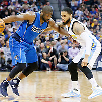 06 March 2016: Denver Nuggets guard D.J. Augustin (12) defends on Dallas Mavericks guard Raymond Felton (2) during the Denver Nuggets 116-114 overtime victory over the Dallas Mavericks, at the Pepsi Center, Denver, Colorado, USA.