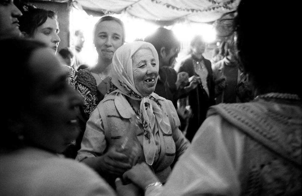 Engagement party in a Kosovo roma family - After the price has been agreed on - everybody old and young drink, eat and dance heavily for a few hours. The only person, who does not party that day is the groom, he has to stay at home. Then the groom?s family returns home - when they can afford it they will have a party at their home and the wedding will be finalised. ..Lapje Selo enclave.