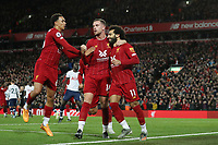 Football - 2019 / 2020 Premier League - Liverpool vs. Tottenham Hotspur<br /> <br /> Mohamed Salah of Liverpool celebrates scoring his sides second goal with Jordan Henderson and Trent Alexander-Arnold to make the score 2-1, at Anfield.<br /> <br /> COLORSPORT/PAUL GREENWOOD