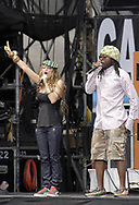 """PHILADELPHIA - JULY 02:  Singer Fergie and rapper Will.I.Am of Black Eyed Peas perform on stage at """"Live 8 Philadelphia"""" at the Philadelphia Museum of Art July 2, 2005 in Philadelphia, Pennsylvania. The free concert is one of ten simultaneous international gigs including London, Berlin, Rome, Paris, Barrie, Tokyo, Cornwall, Moscow and Johannesburg. The concerts precede the G8 summit (July 6-8) to raising awareness for MAKEpovertyHISTORY.  (Photo by William Thomas Cain/Getty Images)"""