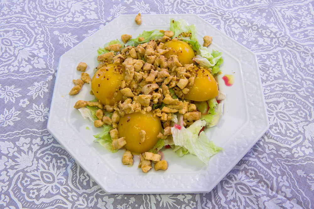 Chicken with spices<br /> Serves 2<br /> Ingredients:  2 chicken breasts<br /> 1 teaspoon of chicken ready mix spices<br /> 3 teaspoon Dijon mustard<br /> &frac14; teaspoon black pepper<br /> 6 tablespoons olive oil<br /> &frac12; iceberg lettuce<br /> &frac12; cup walnuts<br /> 3 tinned peaches<br /> Raspberry sauce<br />  <br /> Preparation:<br />  Rub the chicken spices to the chicken and marinade for 2 hrs<br />  In a cup mix the mustard with the pepper the olive oil and a bit of water<br />  Grind the walnuts<br />  Stir fry the chicken until is cooked<br />  Place the lettuce leaves on a plate, add the peaches, sprinkle the walnuts, add the chicken on the top, pour the mustard dressing and then bit of raspberry sauce
