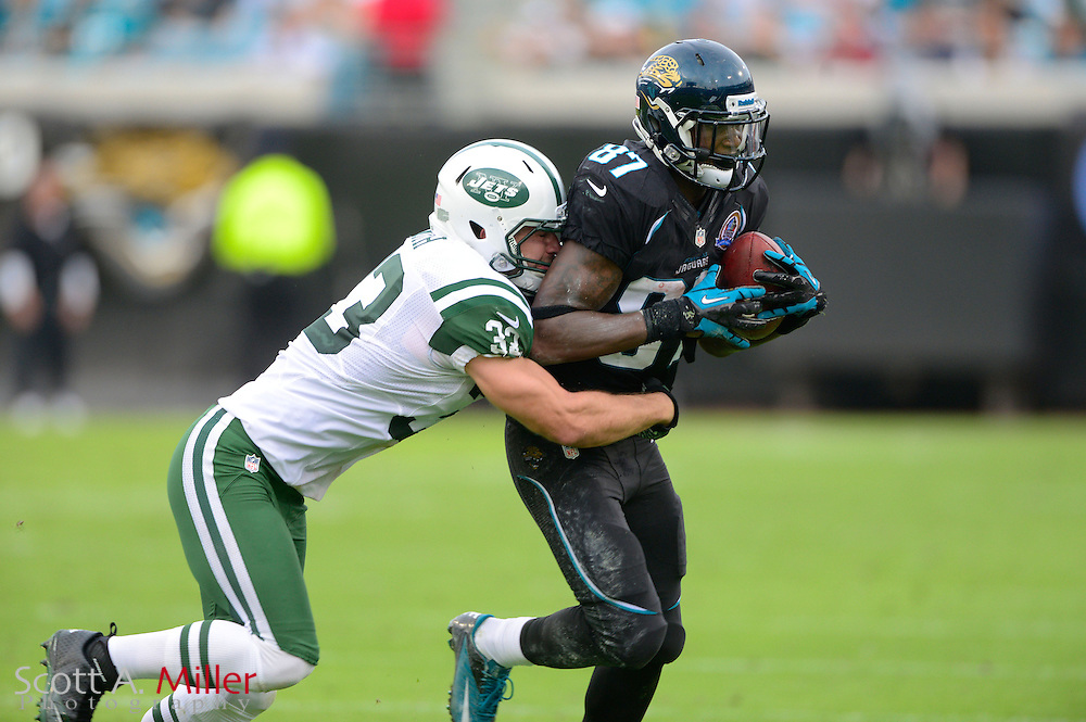 Jacksonville Jaguars wide receiver Anthony Armstrong (87) is tackled by New York Jets free safety Eric Smith (33) during an NFL game against the New York Jets at EverBank Field on Dec 9, 2012 in Jacksonville, Florida. The Jets won 17-10...©2012 Scott A. Miller..