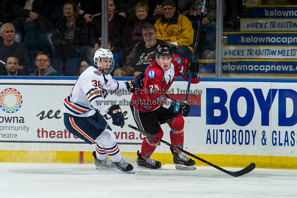KELOWNA, CANADA - MARCH 9: Jackson Caller #38 of the Kamloops Blazers back checks Nolan Foote #29 of the Kelowna Rockets during second period on March 9, 2019 at Prospera Place in Kelowna, British Columbia, Canada.  (Photo by Marissa Baecker/Shoot the Breeze)