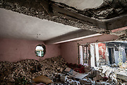 9 August 2018 &ndash; Mosul &ndash; Iraq &ndash; Inside a home that was taken over by ISIS militants in the Bab al-Jaded neighborhood of Ghizlani, West Mosul. In order to avoid being seen and targeted while moving between houses, ISIS militants built tunnels and broke through walls to create hidden passages between buildings. <br /> <br /> This home is amongst the houses due to be rehabilitated in West Mosul with the support of UNDP&rsquo;s Funding Facility for Stabilization (FFS). <br /> <br /> &copy; UNDP Iraq / Claire Thomas