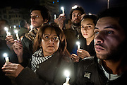 "Egyptian protesters carry vigil candles to honor ""shaheed,"" or martyrs—those Egyptians who died during protests in Tahrir Square, Cairo. More than three hundred Egyptians perished in protests across the country calling for the ouster of President Hosni Mubarak."