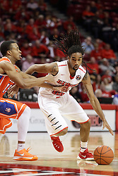 21 November 2015: Tony Wills(12) moves hard past Reveal Chukwujekwu(15). Illinois State Redbirds host the Houston Baptist Huskies at Redbird Arena in Normal Illinois (Photo by Alan Look)