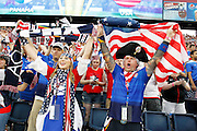 Fans react as team USA enters the field before a CONCACAF Gold Cup soccer match against Panama, Monday, July. 13, 2015, in Kansas City, Kan. (AP Photo/Colin E. Braley)