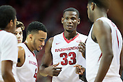 FAYETTEVILLE, AR - NOVEMBER 13:  Moses Kingsley #33 of the Arkansas Razorbacks leads the huddle during a timeout against the Southern University Jaguars at Bud Walton Arena on November 13, 2015 in Fayetteville, Arkansas.  The Razorbacks defeated the Jaguars 86-68.  (Photo by Wesley Hitt/Getty Images) *** Local Caption *** Moses Kingsley