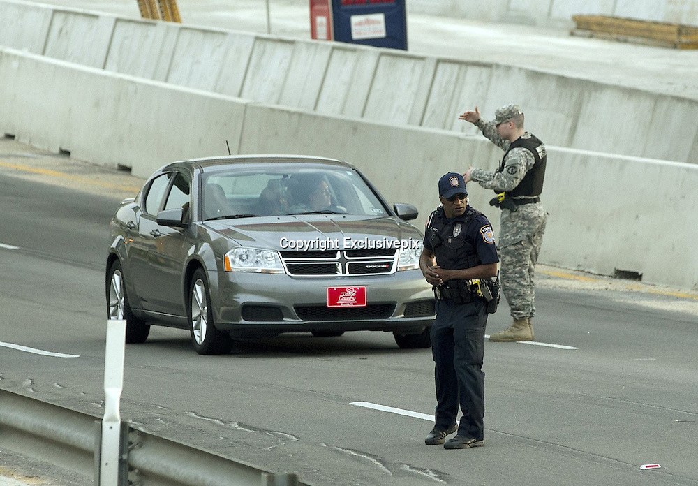 April 2, 2014 - Fort Hood, TX, USA - <br /> <br /> Gunman Kills 3, Wounds 16 at Fort Hood Army Base<br /> <br /> A Bell County Sheriff's Department official stands near his vehicle as cars are checked at the Bernie Beck Main Gate at Fort Hood. An Iraq War veteran being treated for mental illness opened fire Wednesday on fellow service members at the Fort Hood military base, killing three people and wounding 16 before committing suicide at the same post where more than a dozen people were slain in a 2009 attack.<br /> ©Exclusivepix