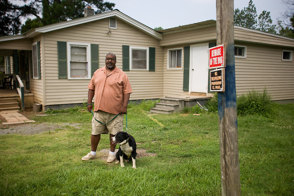 Eddie Ambrose Greene, with Buster, outside his home in Siler City, NC, Tuesday, July 30, 2008.