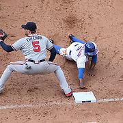 Curtis Granderson, New York Mets, dives back to first base as first baseman Freddie Freeman, Atlanta Braves, catches the ball during the New York Mets Vs Atlanta Braves MLB regular season baseball game at Citi Field, Queens, New York. USA. 23rd April 2015. Photo Tim Clayton