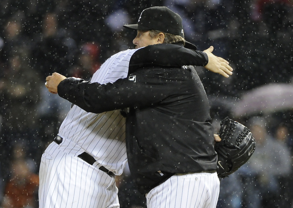 CHICAGO - SEPTEMBER 27:  Mark Buehrle #56 embraces manager Don Cooper #21 of the Chicago White Sox after being removed from the game during the eighth inning against the Toronto Blue Jays on September 27, 2011 at U.S. Cellular Field in Chicago, Illinois.  Buehrle's appearance could be his last in a White Sox uniform. The White Sox defeated the Blue Jays 2-1.  (Photo by Ron Vesely)   Subject: Mark Buehrle;Don Cooper..